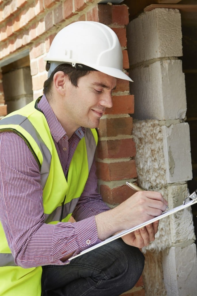 Architect-Checking-Insulation-During-Construction-Project-000044046848_Medium